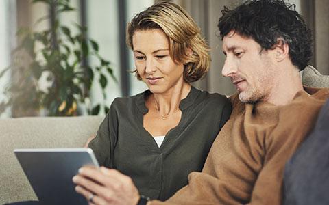 parents on tablet